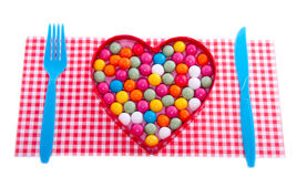 A valentine heart filled with candy Stock Photo