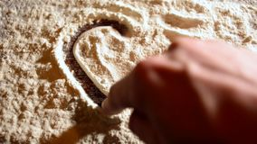 Valentine heart on flour. stock video