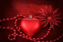 Valentine heart with flower on red background Stock Image