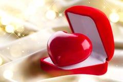 Valentine heart on golden silk background Stock Photography