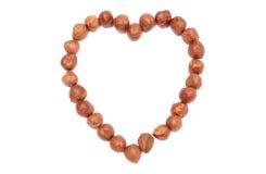 Valentine heart of hazelnut on white background Royalty Free Stock Photos