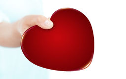 Valentine heart holded by hand isolated over white Royalty Free Stock Photography