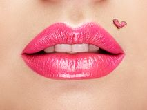 Lips painted with a lipstick heart Royalty Free Stock Images