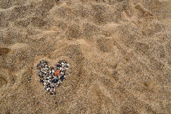 Valentine heart. Heart made with pebbles on the beach sand Stock Images