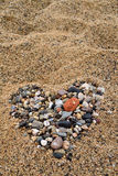 Valentine heart. Heart made with pebbles on the beach sand Stock Image