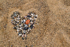 Valentine heart. Heart made with pebbles on the beach sand Stock Photo