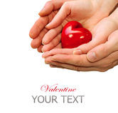 Valentine Heart in Man and Woman Hands. Isolated on white Royalty Free Stock Photo