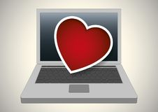 Valentine heart over a laptop computer Royalty Free Stock Images