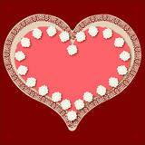 Valentine heart on a pink iced cake Stock Photography