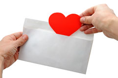 Valentine heart put into envelope Stock Image