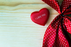 Valentine heart with red dotted ribbon Stock Images