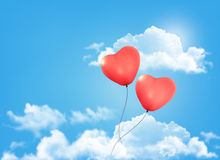 Valentine heart-shaped baloons in a blue sky with  Royalty Free Stock Image