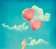 Valentine heart-shaped baloons in a blue sky with  Stock Image
