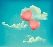 Valentine heart-shaped baloons in a blue sky with  Royalty Free Stock Images