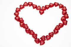 Valentine heart shaped chocolates. Heart-shaped red chocolates arranged in a heart looking shape, good for valentine cards and greetings royalty free stock images