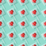 Valentine heart shaped lollipops seamless pattern. Valentine`s Day heart shaped lollipops seamless pattern. Retro candy background, be mine Stock Images