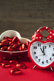 Valentine heart shaped red love clock with chocola. Tes. Time for sweet love Stock Image
