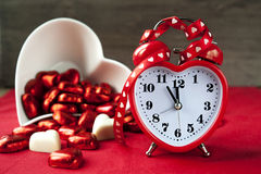 Valentine heart shaped red love clock with chocola Royalty Free Stock Images