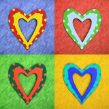 Valentine hearts. Four colorful valentine hearts on textured background royalty free stock photos