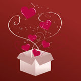 Valentine Hearts. Exploding out of a gift box Stock Photography