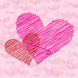 Valentine hearts connected with safety pin Royalty Free Stock Photography