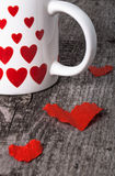 Valentine hearts and cup of tea on the old wooden table Royalty Free Stock Photos