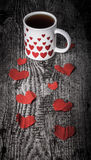 Valentine hearts and cup of tea on the old wooden table. Toned Royalty Free Stock Photography