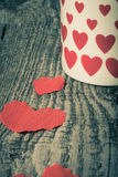 Valentine hearts and cup of tea on the old wooden table. Toned Royalty Free Stock Image