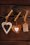 Valentine hearts hanging on wooden background Royalty Free Stock Photo