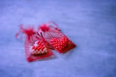 Valentine hearts in red mesh bag Royalty Free Stock Photography