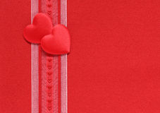 Valentine hearts and ribbon on a red background Royalty Free Stock Photo