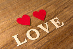 Valentine hearts on rustic wooden background Stock Image