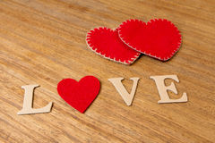 Valentine hearts on rustic wooden background Royalty Free Stock Photos