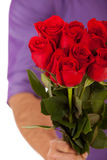 Valentine: Holding Out A Dozen Roses In Bouquet Royalty Free Stock Image