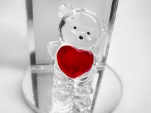 Valentine I love you red heart and teddy bear figurine standing on glass mirror Royalty Free Stock Image