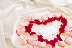 Valentine illustration. Petals heart on a background of silk Stock Photography