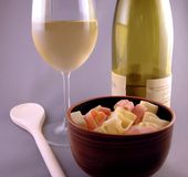 Valentine Italian Dinner with Wine. Italian cuisine with heart shaped valentine pasta noodles and chardonnay wine Stock Photos