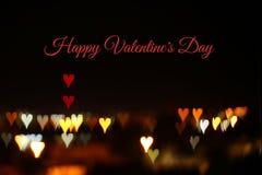 Valentine& x27 ; le fond romantique de bokeh de scintillement de jour de s avec beaucoup de coeurs s'allume Photo stock