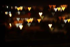Valentine& x27 ; le fond romantique de bokeh de scintillement de jour de s avec beaucoup de coeurs s'allume Photos libres de droits