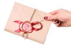 Valentine letter. Wonam's hand holding Valentine letter royalty free stock photography