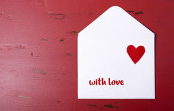 Valentine letter envelope on red background. Royalty Free Stock Image