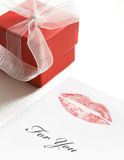 Valentine lipstick kiss. And little red gift box with transparent white ribbon stock photos