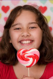 Valentine lollipop and girl Stock Photo