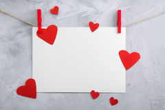 Valentine, love background with paper and hearts on a rope Royalty Free Stock Photo