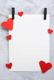Valentine, love background with paper and hearts on a rope Stock Photos