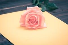 Valentine love heart fresh pink rose on yellow stock photos