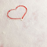 Valentine love red heart shape in snow on red background. Royalty Free Stock Photos