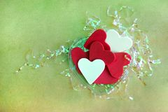 Valentine Love. Red hearts and white pattern on brown paper over the top and empty space for text Royalty Free Stock Images