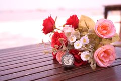 Valentine and love relation. Rose and clock background for valentine and love royalty free stock photography