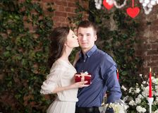 Man makes gift, box for his girlfriend. Valentine, love and relationship. tenderness Royalty Free Stock Photos
